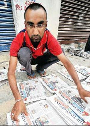 N Shiva Kumar Newspaper vendor from Bangalore walks into IIM-Calcutta