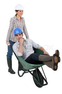 8305420-303407-craftswoman-carrying-a-craftsman-sitting-in-a-wheelbarrow