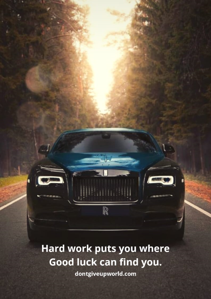 Blue-black Rolls Royce Standing on highway surrounded by forest, Depicting hard work can lead to  good luck